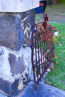 Slightly damaged, and probably not used, metal gate.