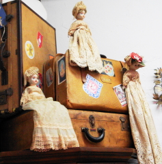 Old dolls and old suitcases.