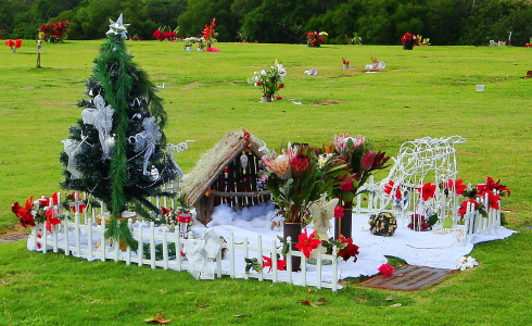 Grave site decorated for Christmas